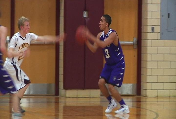 EC Memorial's Malek Lemke lines up a shot as the Old Abes win at Menomonie