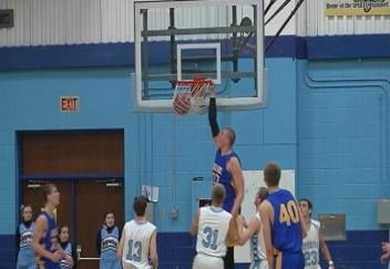 Rice Lake's Henry Ellenson throws one down but the Warriors lose at Superior