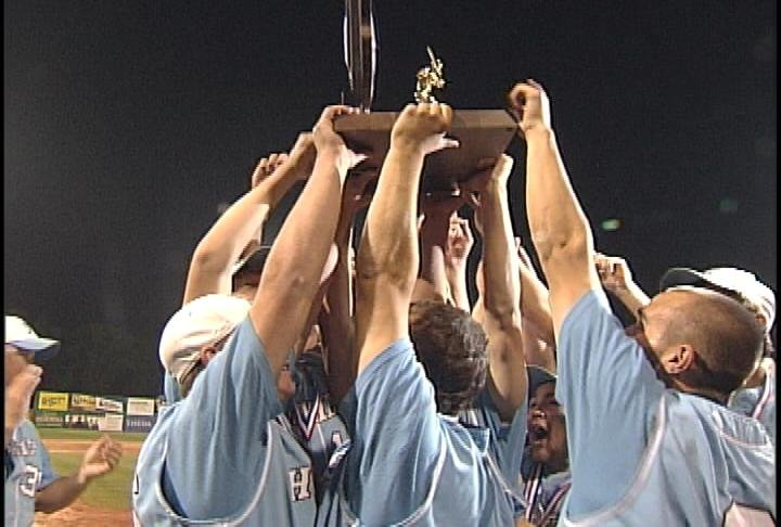 EC North players hoist the 2011 WIAA Division 1 State Championship trophy