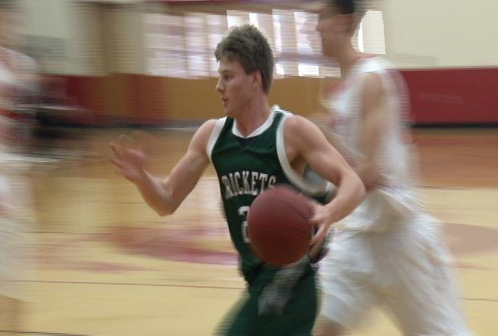 Connor Ishe drives hard to the hoop for Fall Creek
