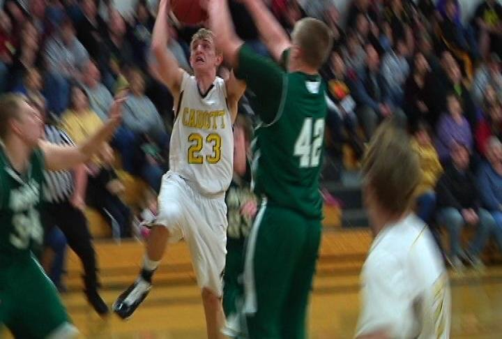 Cadott's Austin Poehls takes it to the hoop as the Hornets defeat EC Regis