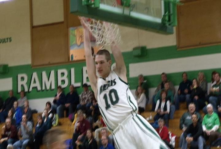 Billy Wampler slams one down as Regis wins at home over Osseo-Fairchild
