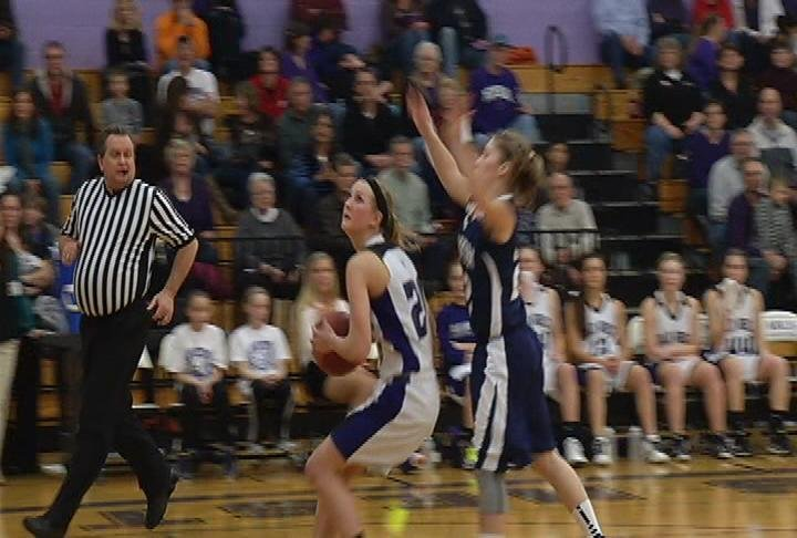 EC Memorial's Lauren Novak goes up for 2 as the Old Abes beat Hudson