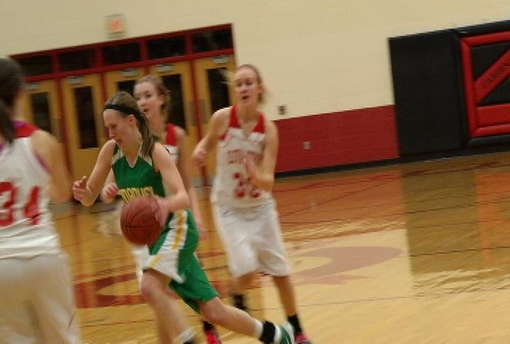 Immanuel Lutheran's Abbie Hein heads to the hoop as the Lancers win at Eleva-Strum