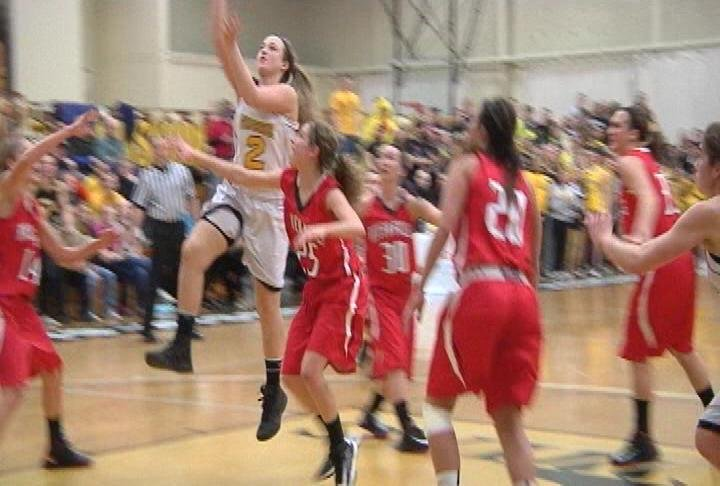 Grace Kennedy glides to the hoop as UW-Superior defeats UW-River Falls