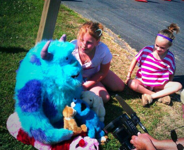 Children are placing their favorite stuffed animals for little Isaiah Theis near his home as a memorial.
