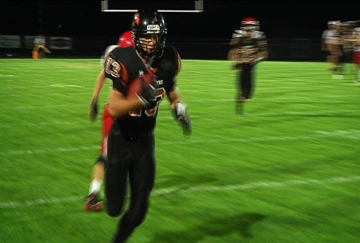 Bloomer's Ryan Buske races down the sidelines on a 66-yard TD reception