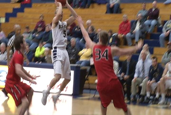 Adam Hjelter goes up for 2 of his 15 points in UWEC's win over UWRF