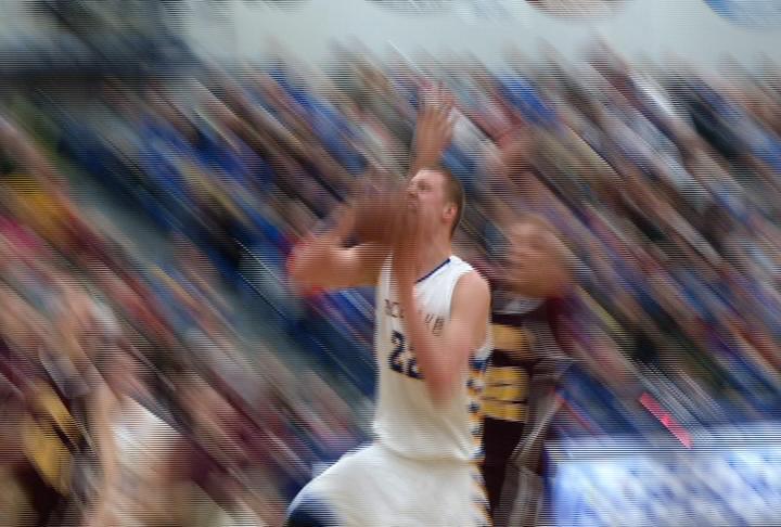 Henry Ellenson takes it to the hoop as Rice Lake defeats Menomonie