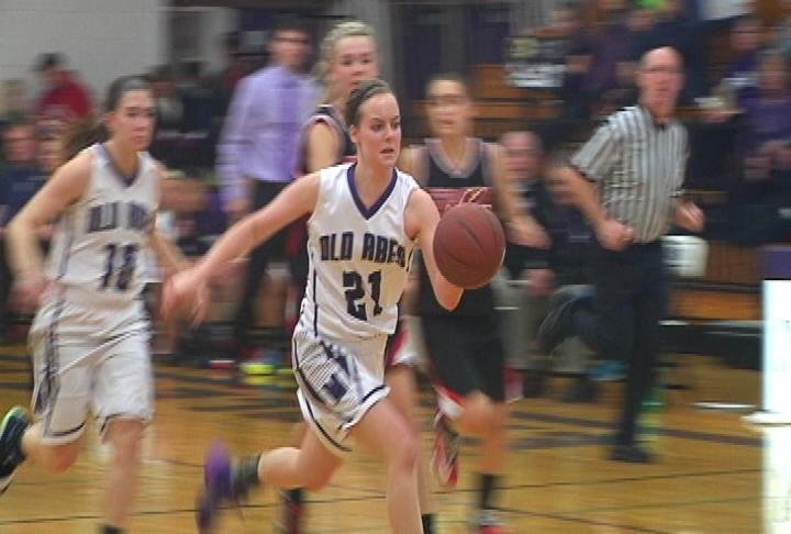 EC Memorial's Kaci Gorres drives to the basket against Stevens Point