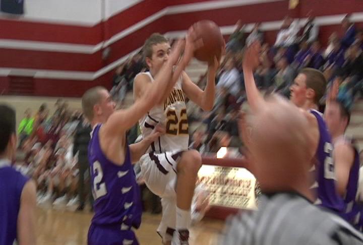 Menomonie's Nate Stanley takes it to the hoop in a win over EC Memorial
