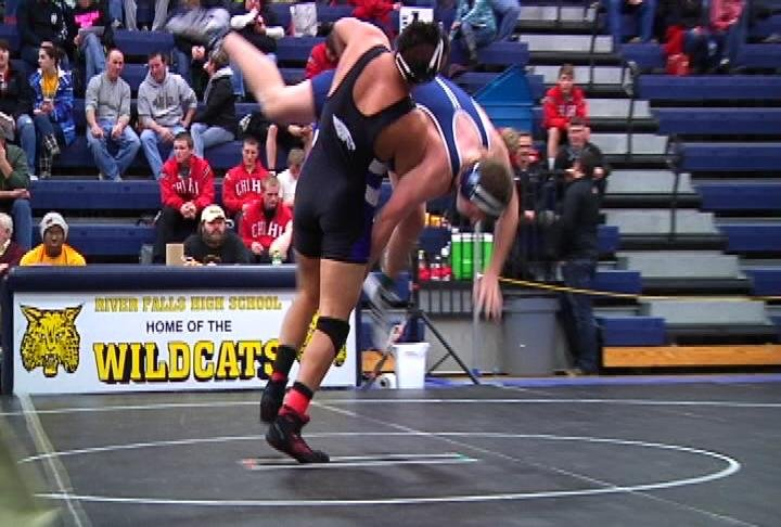 ECM's Othayun Smith gets a takedown at the River Falls Regional