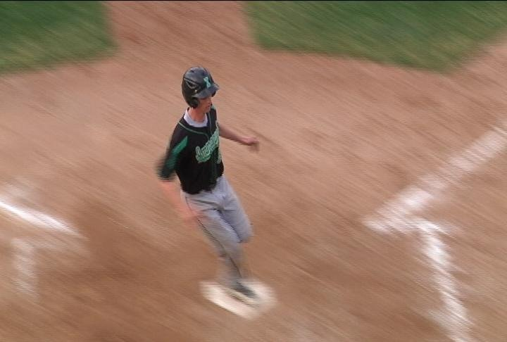 Immanuel Lutheran's Tim Schaller scores the game-winning run vs. Augusta