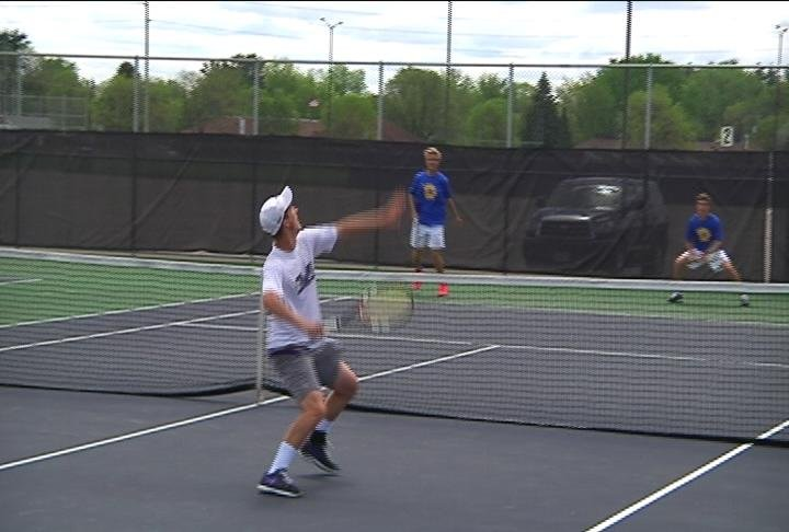 ECM's Zach Wolfe winds up for a slam