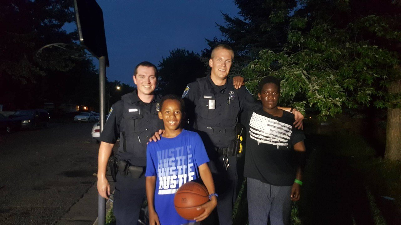eau claire police surprise kids with basketball game wqow tv