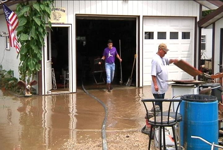 Families Clean Up After Major Flood Hits Decorah Iowa