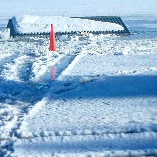 Ice shanty falls through ice near colfax for Wisconsin ice fishing resorts