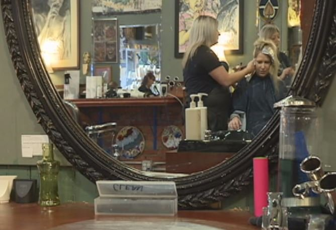 Eau claire salon supports domestic violence training for 007 salon madison wi
