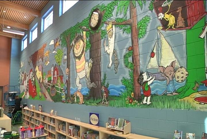 Art teacher paints mural in menomonie elementary school for Elementary school mural