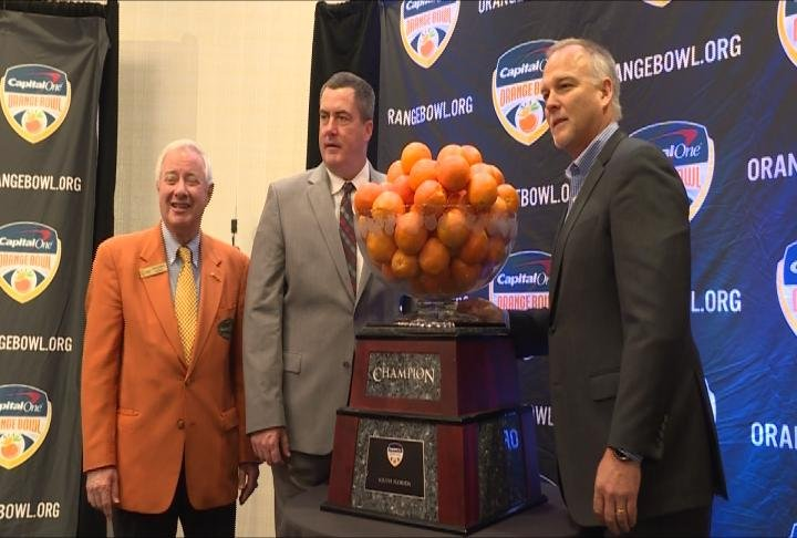 Paul Chryst & Mark Richt pose with the Orange Bowl trophy