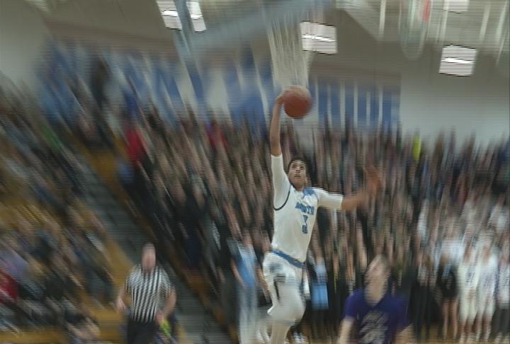 Dalton Banks throws down a dunk as the Huskies beat Memorial
